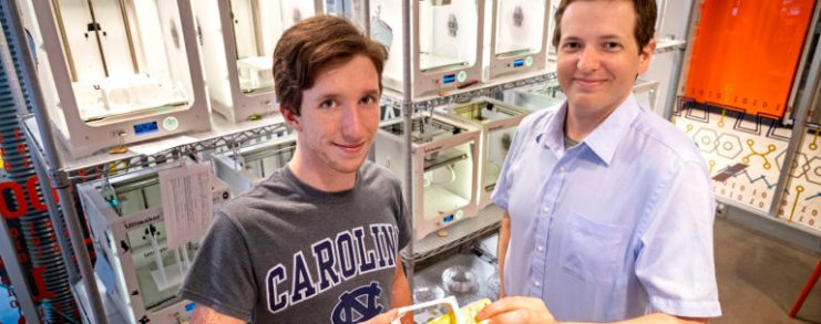 UNC senior Patrick Gorman and assistant professor Andrew Mann use 3D printers in the Murray Hall Makerspace to create models of components for small satellites. (Jon Gardiner '98/UNC)